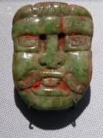 Carved jade pendant showing the face of the Sun God, K'inich Ajaw, 475-500 CE, Honduras, Copan. (U of Pennsylvania Museum, Philadelphia)