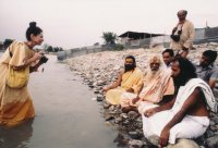 Standing in river Ganges and photographing during a seminar of Eco-Environmental Himalayan Culture organized by Vraja Academy, Vrindavan, at the Maha Kumbha Mela, Hardwar, India, 1986. At far right is Vraja Academy founder Baba Sri Padaji Maharaj. To his right is Vaishnav sage-scholar H.H. Sri Prabhudatta Brahmachariji Maharaja.
