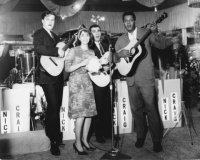"Performing in US clubs and on TV as the female singer in the folk group ""Casey Anderson and The Realists."" From left to right Gary Fishbaugh, Norma Green, Frank Martin, Casey Anderson."