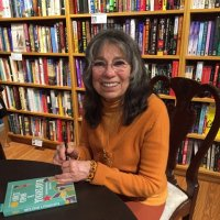 Signing books at book launch of *Once Upon a Yugoslavia* at Main Point Books, Bryn Mawr, Pennsylvania, November 17, 2015.